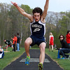 Hamilton-Wenham junior Tyler Mulley prepares to land during the triple jump on Wednesday afternoon. David Le/Staff Photo