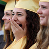 Bishop Fenwick graduate Catherine Hoxha laughs at a joke told by Senior Class President Robert Liberge during Commencement on Friday evening. David Le/Staff Photo