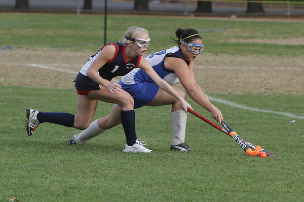 Danvers High School's Lindsay Gotts, right, gets a stick on the ball to stop Lincoln-Sudbury's Hannah Lawless on Thursday afternoon. David Le/Salem News