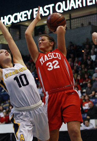 Masco senior Brooke Stewart (32) right, gets fouled while shooting by Andover's Devon Caveney (10) left, during the D1 North Final on Saturday afternoon. David Le/Staff Photo