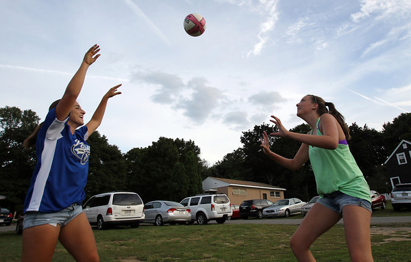 Sabrina D'Angelo, 15, left, and Emily Diezemann, also 15, both from Peabody, play volleyball at Forest River Park in Salem on Tuesday evening. David Le/Staff Photo