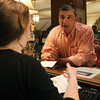 Jeff Lewis, of Wayne, PA, is checked into the Hawthorne Hotel by front desk employee Melissa Kelly on Friday afternoon. David Le/Staff Photo