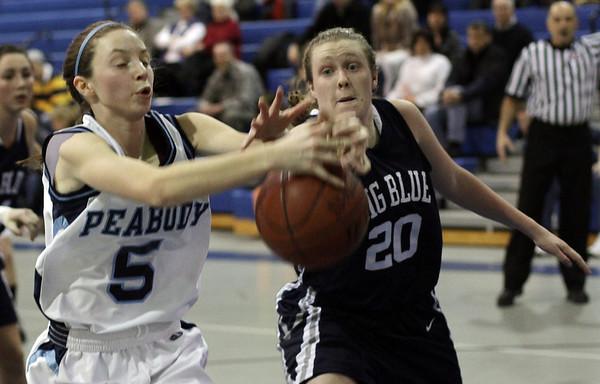 Peabody's Taylor Provost (5) left, and Swampscott's Caroline Murphy (20) battle for a loose ball. David Le/Salem News