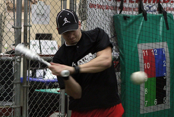 Bobby Trickett, a senior baseball player from North Andover tries out a new aluminum bat at Extra Innings in Middleton on Thursday night. David Le/Salem News