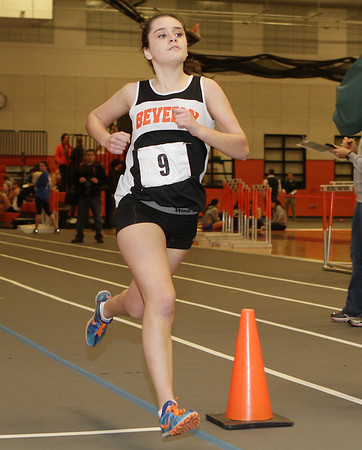 Beverly: Beverly's Nicole Demars crosses the finish line to take first place in the girls two-mile race on Thursday. David Le/Salem News