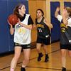 Peabody: Bishop Fenwick tri-captain Lauren Moulton (35) left, grabs a rebound and looks to pass. David Le/Salem News