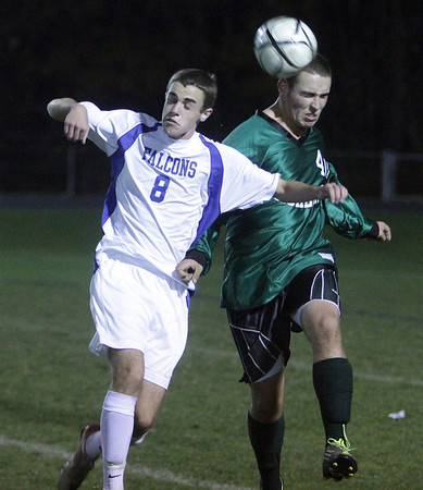 Danvers High School's Zach Noring (8) left, battles for a header with a Pentucket player on Wednesday night. David Le/Salem News