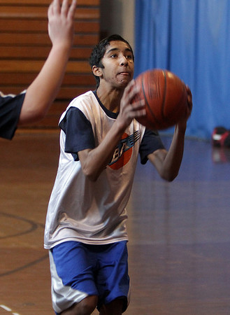Ahmed Rabbani lines up a shot during a PBA basketball game on Saturday morning. David Le/Salem News