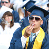 Peabody High School Treasurer Danny Indorato blows celebratory bubbles after receiving his diploma on Friday evening. David Le/Staff Photo
