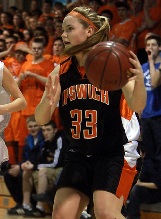 Ipswich junior Brigid O'Flynn (33) looks to pass against Bedford on Wednesday night. David Le/Staff Photo