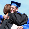 Danvers High School senior Michael Scarfo hugs Principal Susan Ambrozavitch after receiving his diploma on Saturday afternoon. David Le/Staff Photo