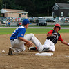 Marblehead runner Thomas Brant, right, slides safely into third base as the ball squirts away from Peabody third baseman Tyler MacGregor on Tuesday evening in the Gallant Tournament Final. David Le/Staff Photo