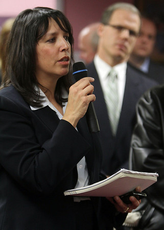 Salem Mayor Kim Driscoll addresses a packed room of concerned North Shore citizens and officials from the MBTA regarding a proposed plan to cut services and increase fares across the North Shore. David Le/Salem News