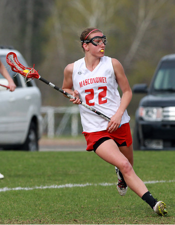 Masco midfielder Kathleen Gillespie (22) carries the ball against Manchester-Essex on Wednesday afternoon. David Le/Staff Photo