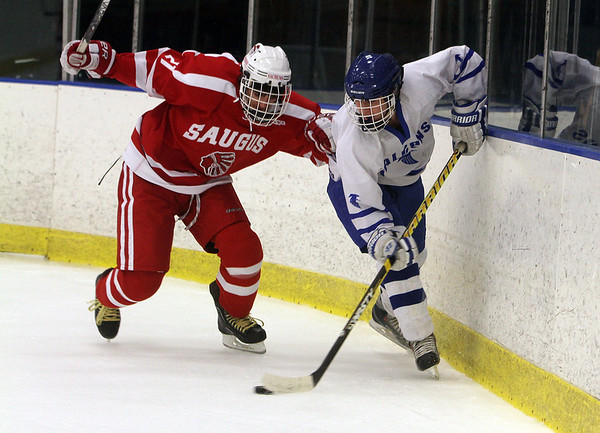 Salem: Danvers' Jack Doyle, right, passes to a teammate against Saugus on Wednesday night. David Le/Salem News