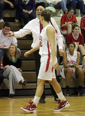 Masco head coach Bob Romeo instructs senior Brooke Stewart on her way back down court on Thursday night. David Le/Salem News