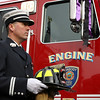 Peabody: Peabody Fire Captain Jay Dowling carries the helmet of good friend, and fellow firefighter Jim Rice as he stands next to Peabody's Engine 5, Rice's former truck, in which he took his last ride on Friday morning. David Le/Salem News