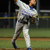 Danvers American relief pitcher Thomas Mento rears back and fires a strike against Andover American on Friday evening. David Le/Staff Photo