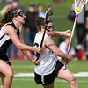 Beverly's Elizabeth Musumeci, right, tries to keep her balance while being defended by Marblehead's Meggie Collins, left, on Wednesday afternoon. David Le/Staff Photo