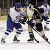 Salem: Danver captain JD Hodgkins fights for a puck with Winthop's Dan Eruzione. David Le/Salem News