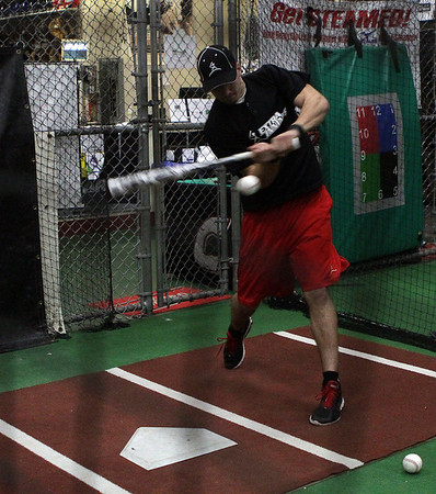Bobby Trickett, a senior at North Andover, tries out a new bat at Extra Innings in Middleton on Thursday. David Le/Salem News