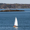 A sailboat glides along the mouth of Marblehead Harbor on a warm Tuesday afternoon. David Le/Staff Photo