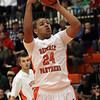 Beverly's Ty Suggs (24) rises up and hits a jump shot on Friday night. David Le/Salem News