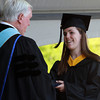 Endicott College graduate Laura Kanarski, of Marblehead, shakes hands with Endicott President Dr. Richard E. Wylie, while being handed her diploma on Saturday morning. David Le/Staff Photo