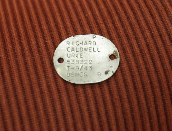 The dogtag for US Marine Richard Urie was lost during WWII and was recently found and returned to Urie, now a resident at Brooksby Village in Peabody. David Le/Salem News