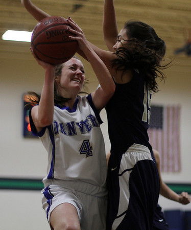 Beverly: Danvers' Sarah Potter gets fouled as she goes in for a layup against Winthrop on Thursday night at Endicott College. David Le/Salem News