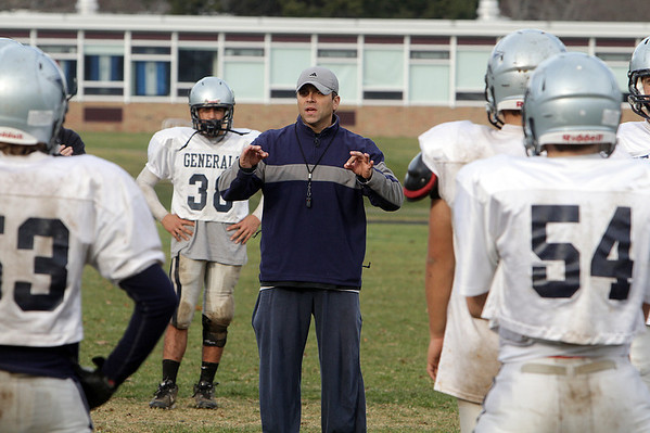 Hamilton-Wenham head football coach Andrew Morency instrusts his team during practice on Sunday morning as they prepare to take on Newburyport on Tuesday night. David Le/Salem News