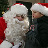 Diego Diaz, 5, of Peabody, talks with Santa Claus at Pope's Landing in Danvers on Saturday morning. David Le/Salem News