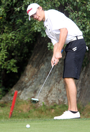 Marblehead senior Connor Green putts against Beverly on Friday at the Beverly Golf and Tennis Club. David Le/Staff Photo