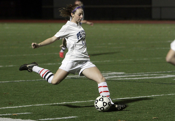 Peabody defender Taylor Provost crosses the ball into the box against Oliver Ames on Tuesday night. David Le/Salem News