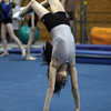 Yellowjackets gymnast Emme Reppas flips over backwards at practice. David Le/Staff Photo.