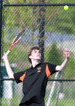 Beverly senior captain and second singles player Justin Brewster serves against Austin Prep on Friday afternoon. David Le/Staff Photo