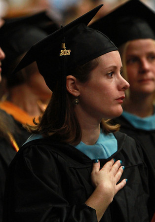 Allison Maden, of Danvers, puts her hand over her heart during the singing of the National Anthem at the start of the Commencement ceremony on Thursday afternoon. David Le/Staff Photo