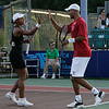 Danvers: Tennis star James Blake of the Boston Lobsters high-fives his teammate Raquel Kops-Jones in mixed doubles play  at the Ferncroft Country Club in Danvers on Thursday evening. Photo by David Le/Salem News