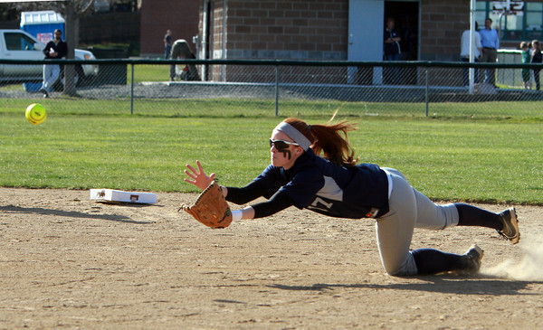 Swampscott second baseman Kelly Birchmore makes a diving catch of a short infield pop up against Danvers on Friday afternoon. David Le/Staff Photo