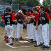 The Marblehead Little League All-Star team greets Derek Marino at home plate after he hit a first inning home run and propelled Marblehead to a 10-7 win over Peabody in the Gallant Tournament Final on Tuesday evening. David Le/Staff Photo