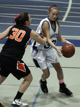 Peabody's Cara Singer (32) right, drives to the hoop against Beverly's Andrea Zelano (30) left. David Le/Salem News