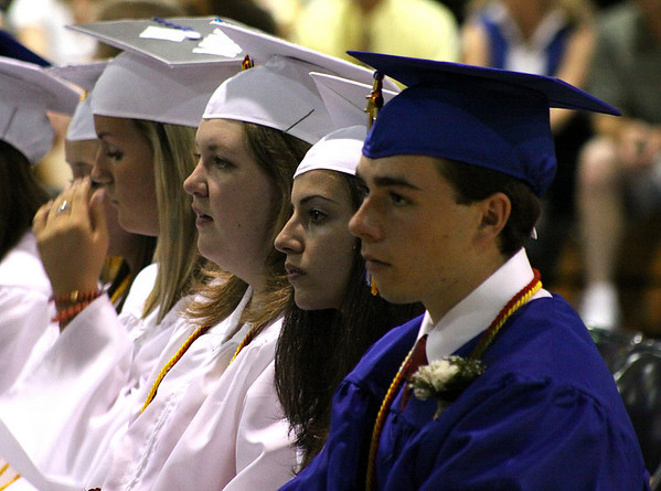 Danvers: From left, Danvers High School Seniors, Kerian Cronin, Alicia Cummings, Adriana Cunha, and Sean Curley, listen to the speeches delivered at their commencement held on Saturday afternoon in the Danvers High Gymnasium. Photo by David Le/Salem News