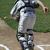 Middleton: Middleton Little League catcher Ethan Harris springs from his crouch to field a bunt at Middleton's practice on Wednesday afternoon. The Middleton LL team is focused and ready for its first game on Saturday in hopes of making it all the way to Williamsport. Photo by David Le/Salem News