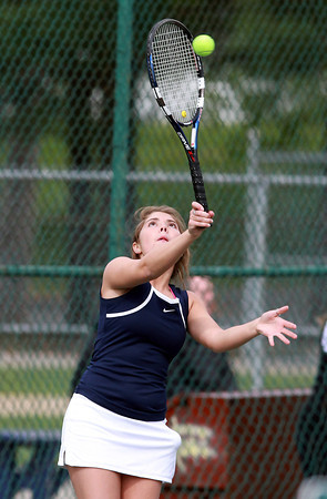 Hamilton-Wenham 3rd singles player Allie Whelan strikes a serve against Danvers on Friday afternoon. David Le/Staff Photo