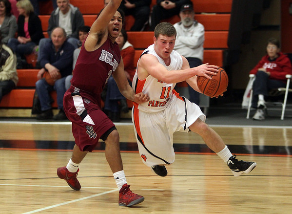 Beverly's Dom Abate (11) drives past Lynn English's Kadeem Greene (3) left, on Friday night. David Le/Salem News