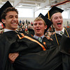 Beverly High School graduates Jonathan Cohen, left, gets a lift from classmate Connor Flynn, center, as Jonathan Ouimet joins the celebration. David Le/Staff Photo
