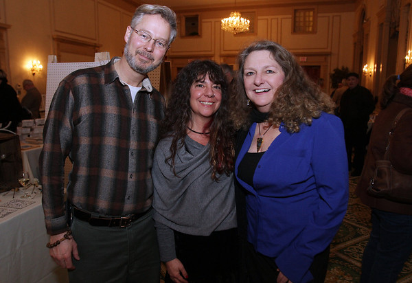 From left, Don Nadeau, Sara Ashodian, and Ellen Hardy, all of Salem, at the 2nd annual exhibit for artists and authors held at the Hawthorne Hotel David Le/Staff Photo
