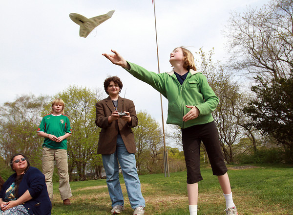 Elsa Richardson-Bach, 11, right, of Marblehead, releases a remote control plane, as her cousin, Josef Riccio, 16, center, of Rocky Hill, CT, operates the controls and her brother Erik, 13, looks on, at Bud Orne Field on Wednesday afternoon. David Le/Staff Photo