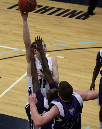 Gordon College freshman Jason Dempsey (14) sinks a jump shot while being defended by two Curry College players on Saturday afternoon. David Le/Salem News