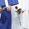 A Danvers High School graduate holds a rose as she walks into her Graduation ceremony on Saturday afternoon. David Le/Staff Photo